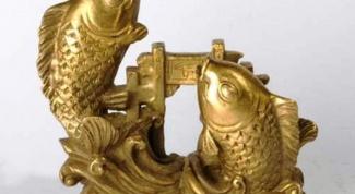 Что означает статуэтка рыба по фен-шую