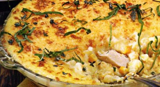 Potato casserole with chicken and cheese in the oven