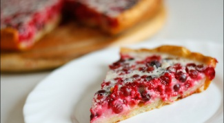 Open pie made of yeast dough with cranberries