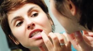 Как устранить припухлость и болезненность десен