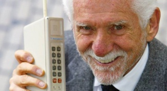 Who invented mobile phone