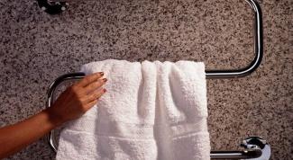 Как выбрать полотенцесушитель: электрический или проточный
