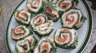 Rolls of pita cream cheese and spinach