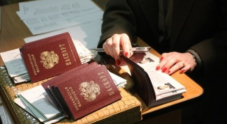 How does the residence permit in the passport