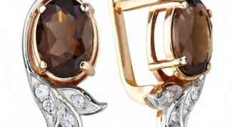 Серебряные и золотые серьги с раухтопазом