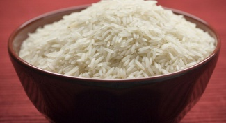 How much water is needed per Cup of rice