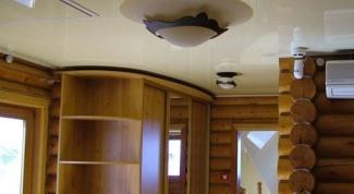 Какой лучше установить натяжной потолок в доме из бруса