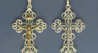 Какой крестик лучше купить: золотой или серебряный