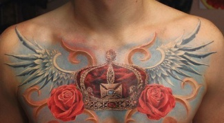 What does the tattoo crown with wings?