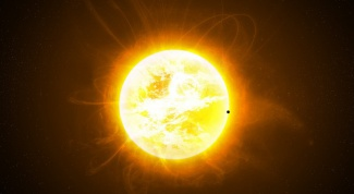 What are the size and the mass of the Sun