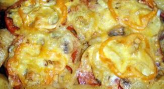 Свиная отбивная в духовке с овощами, сыром или чесноком