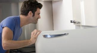 Как перевесить дверцы холодильника на другую сторону