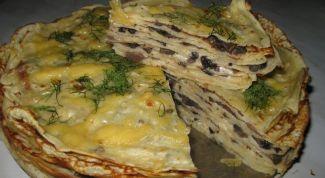 Pancake cake with mushrooms and cheese