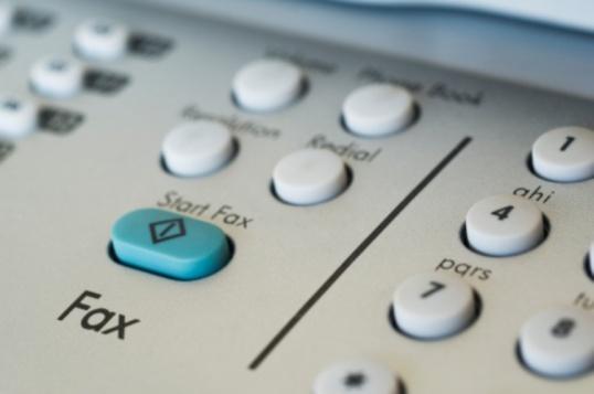 Как вставить бумагу в факс