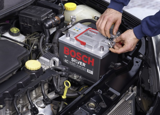How to put the battery in the car