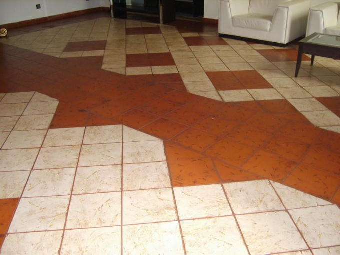 How to stick the tiles on the floor