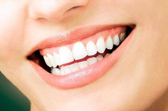 Как сохранить эмаль на зубах