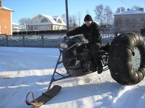 A snowmobile with two wheels and a ski