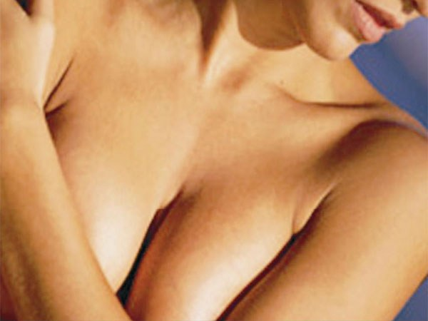 Why before menstruation swelling Breasts