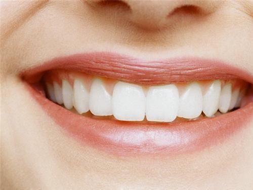 Как нарастить передний зуб