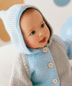 In knitted sweaters and jackets handy hood – a pledge of comfort and warmth