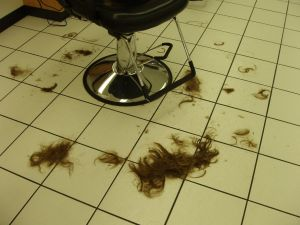 Remains of hair at the end of the sweep with a broom.