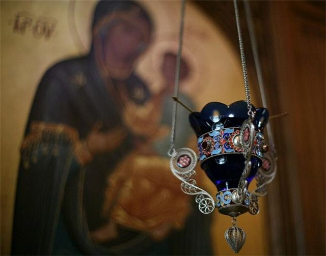 The icon and oil lamp in front of it should be in every home during his consecration