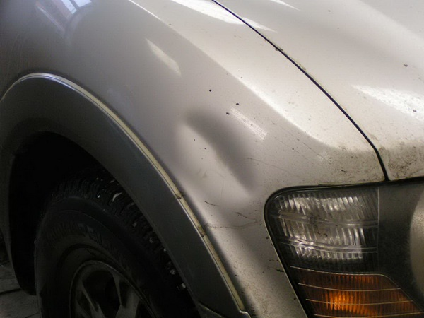 How to remove a dent on a car