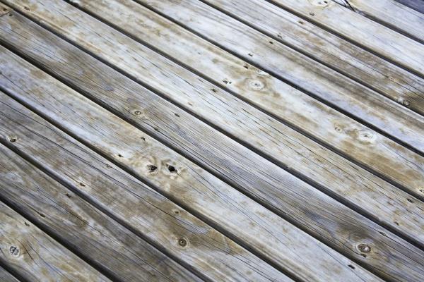 Как выровнять деревянные полы под ламинат