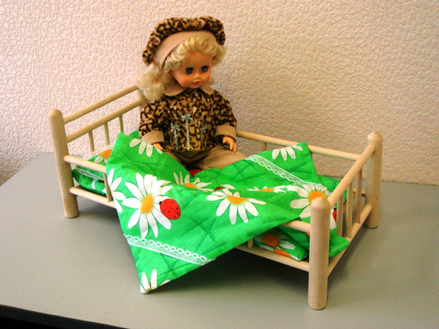 Cots for dolls are different