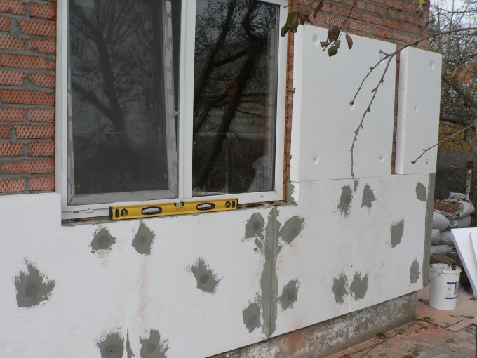 How to insulate a wall in a brick house