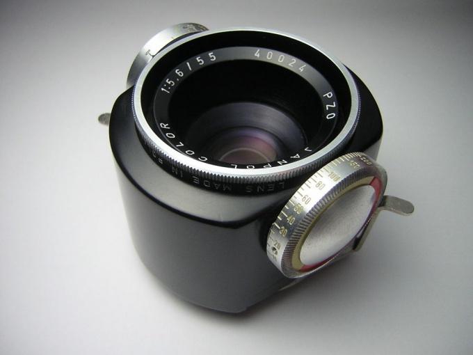На объективе для фотоувеличителя есть ручки, регулирующие диафрагму