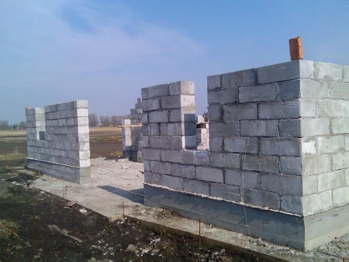 Как определить толщину стены