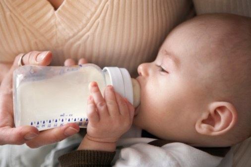 How to hold the bottle when feeding