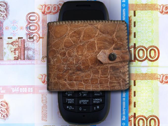 Как обналичить деньги со счета мобильного телефона