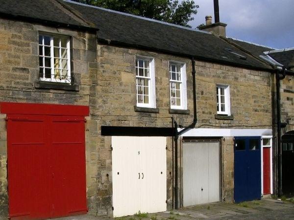 Как построить гараж под домом