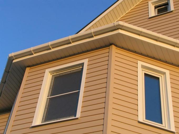 Как отделать дом из бруса
