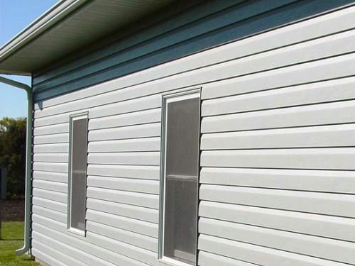 How to sheathe the house with metal siding