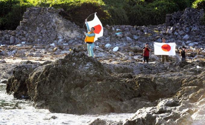 За что Япония депортирует китайских активистов