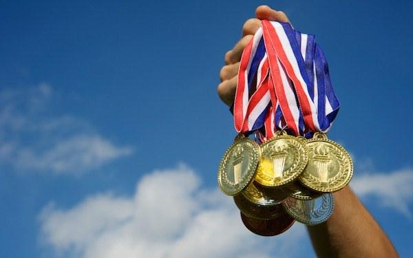 Какая страна чаще всех лидировала по количеству олимпийских медалей