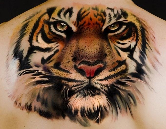 Что означает татуировка в виде тигра