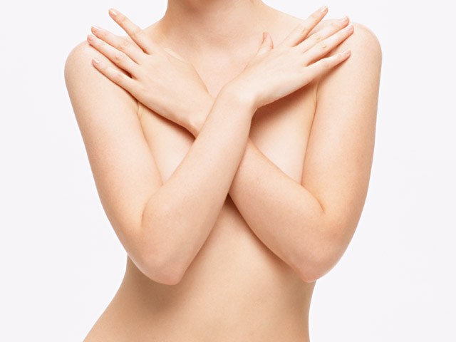 What determines breast size in women