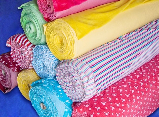 What fabrics and knitwear sit down after washing