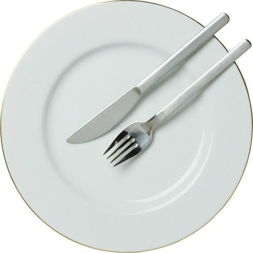 Leave the fork and knife in this position, if you want the waiter removed the plate