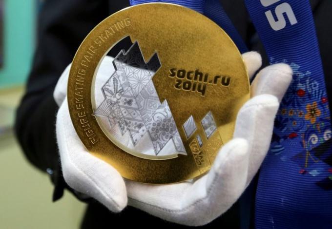 Золотая медаль действительно золотая?