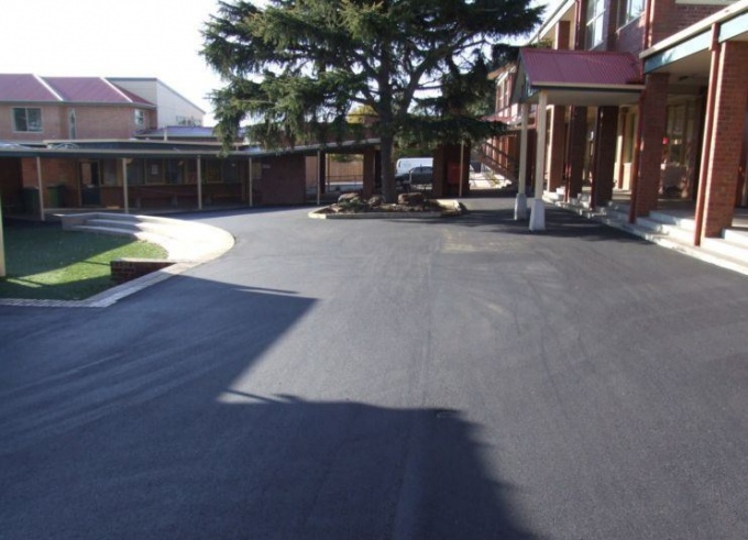 Asphalt laying in the yard