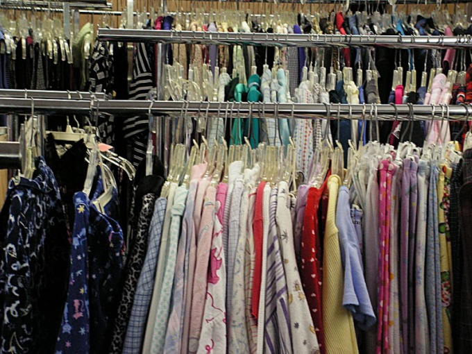 Women's clothing can be seen on the guy