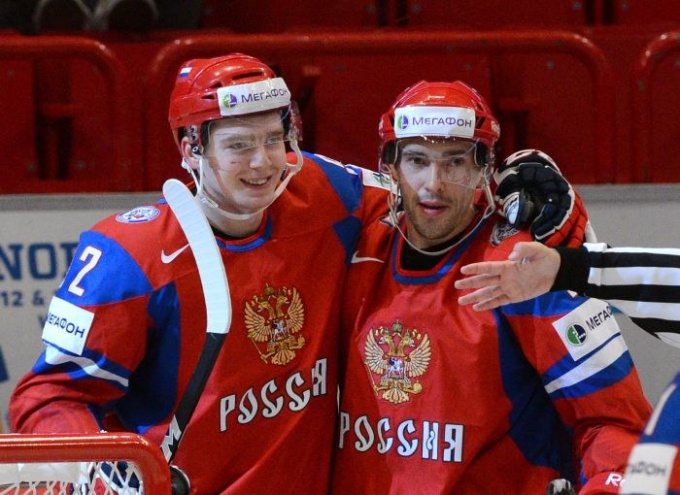 "The captain of the national team of Russia on hockey Pavel Datsyuk (right) his first sports category received in the nursery school ""Yunost"""