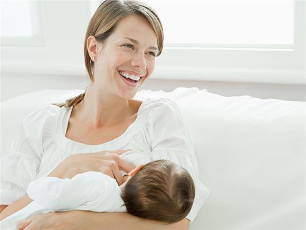 woman feeding baby breast