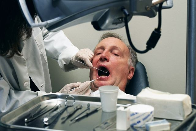 the work of a dentist: what to do with the blackening of the gums?
